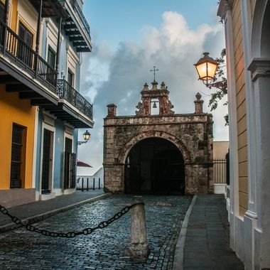 "Chapel of Christ the Savior, Old San Juan, This street is never empty, but this day we walked all over OSJ and this was about the last stop I did to visit ""La Capilla De Calle Cristo"" the story goes like this, On or about 1750 there was a horse race on this street that was common over two hundred years ago, well one day one of the horses kept running after the finish line and towards the end of this street right where the chapel is standing, at the time there was no chaple just a dead end street with a cliff of about close to two hundred foot drop, the horse went over the cliff with it's rider, there was a woman at the balcony on the left home at the end of the street and she screamed ""Save him Christ the Savior!!"" witch the rider did survive but not the horse, the chapel was built in honor of that miracle and also to prevent any further tragedy's"