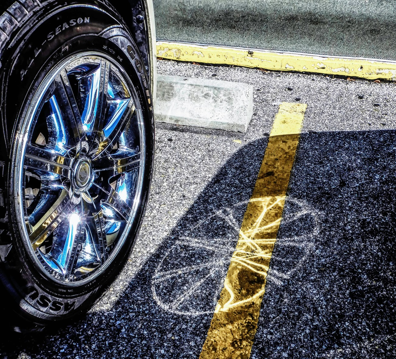 Wonderful reflection on the wet parking lot surface.the yellow lines added just the right amount of color.