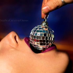 Did this shoot in my living room with my girlfriend, I did her makeup and held this baby disco ball in her mouth as I took the shot.