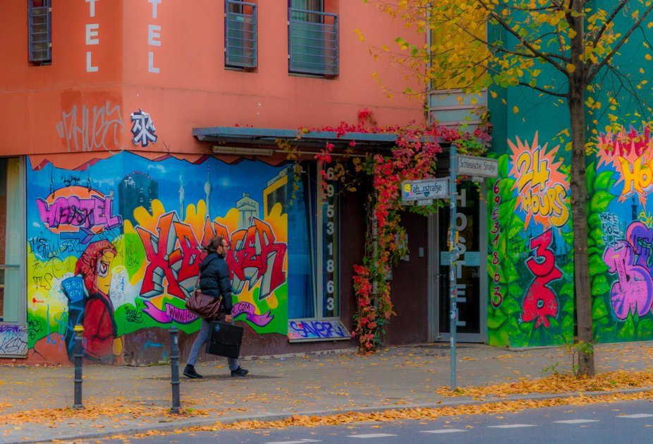 A man walking home on a  colorful street in Berlin