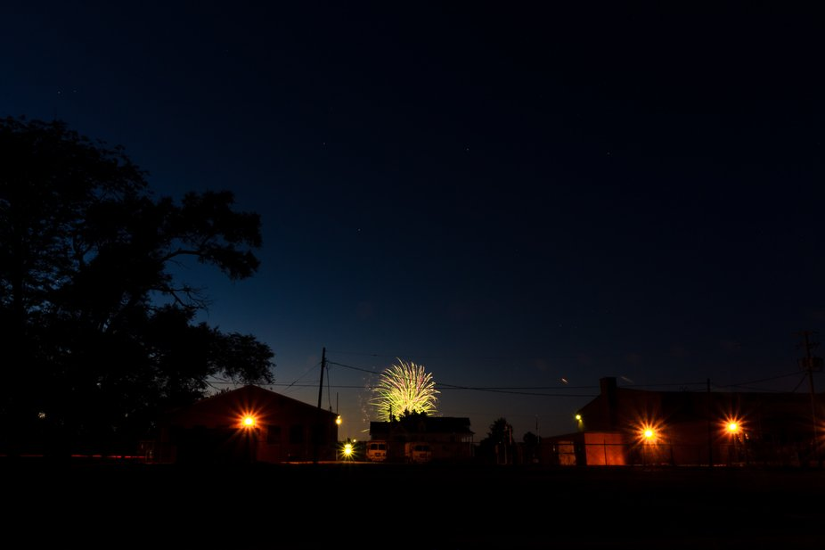A view of the national guard armory during the Fourth of July fireworks.