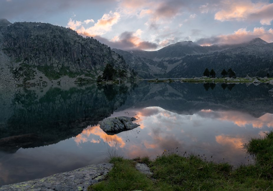 In France, Pyrenees. Neouvielle Mt, Aumar Lake at the sunset.