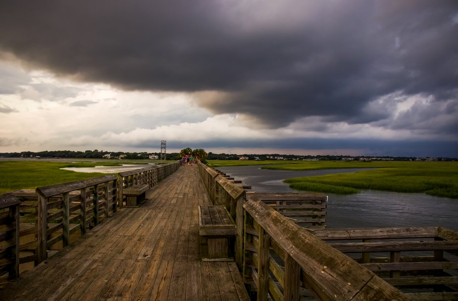 Thunderstorms in the distance at Pitt Street Bridge, Mount Pleasant, SC.