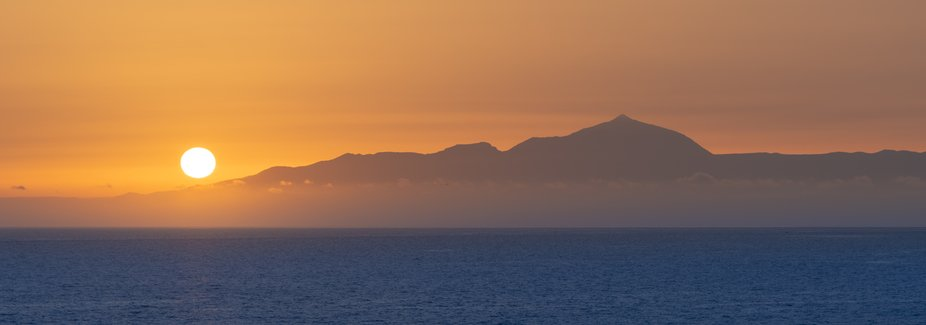 Tenerife, showing El Teide, from the beach in Gran Canaria