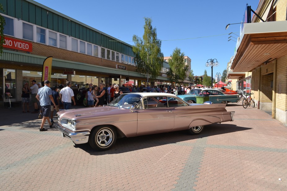Oldtimers on display in the shopping street of Lycksele. People show their cars and you can feel ...