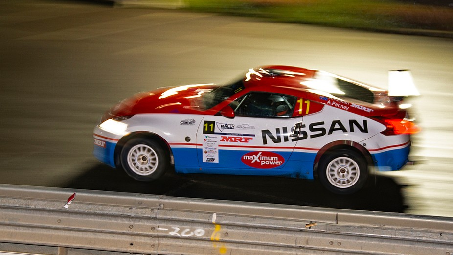 First attempt at photographing Rally cars at night. 1/10th sec, f/4, iso 250 rear sync flash