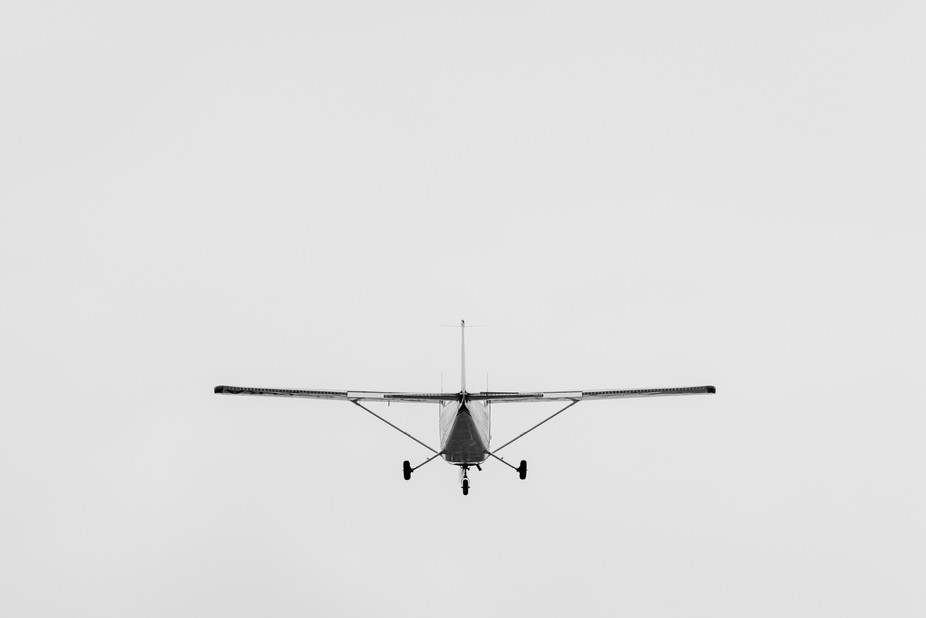 Plane shot from behind, right after takeoff. Converted to BW.