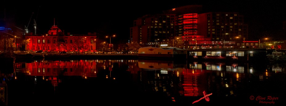 Building around the Hobart water front are lit up during the Dark Mofo winter festival
