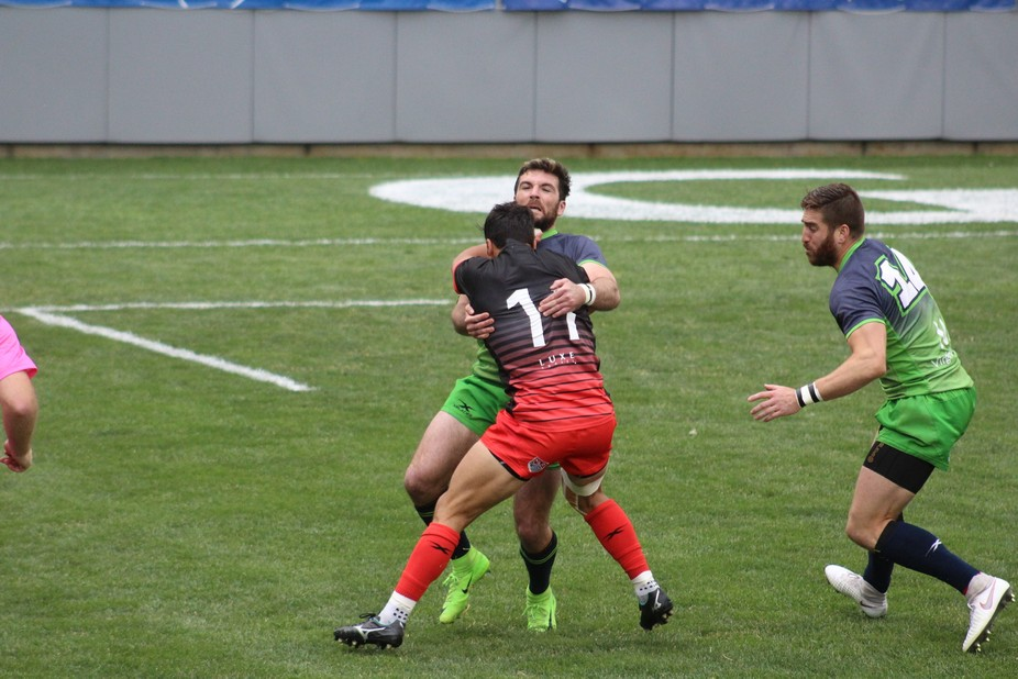 Mat Turner (green cleats) tackles Nate Augsprger in a Seattle Seawolves vs San Diego Legion MLR S...