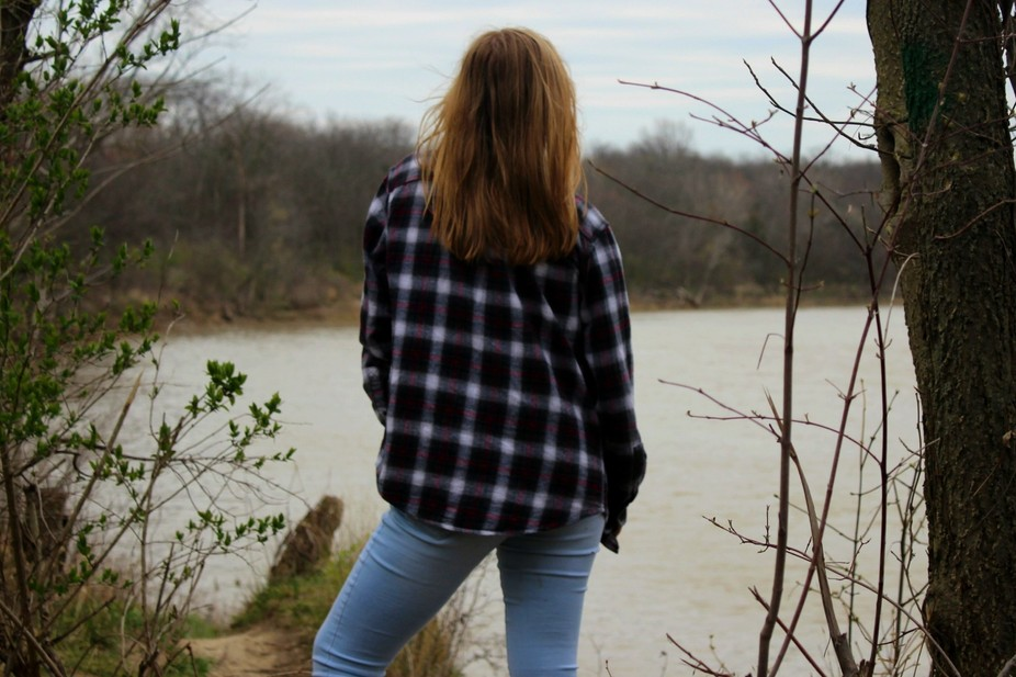 A girl looking out into nature to start a new beginning.