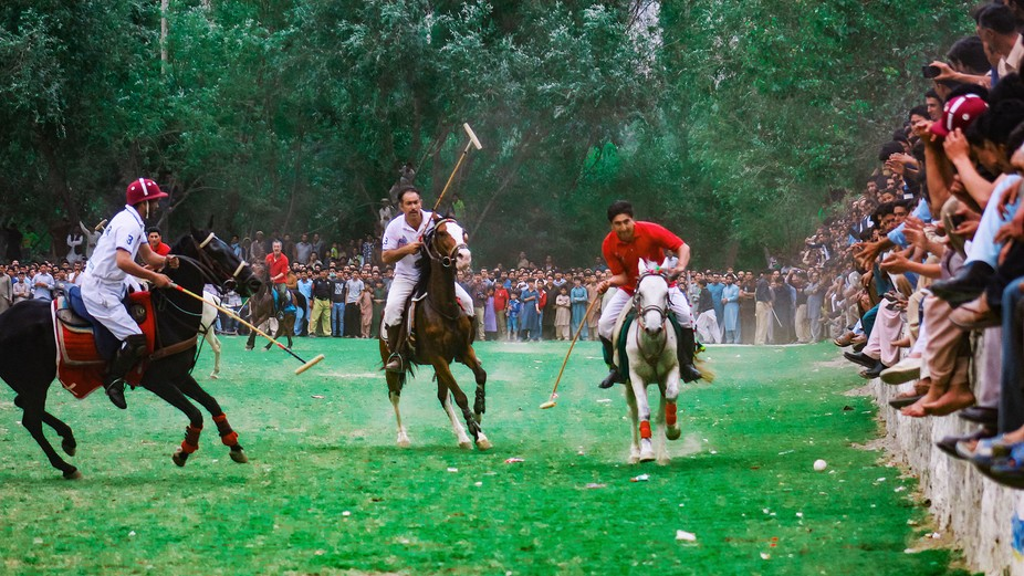 a free style polo is being played in gilgit balistan and people of the region love this game.capt...