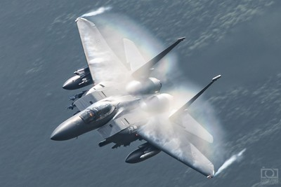 F-15E low and fast through the Welsh valleys creating its own cloud-rainbow.
