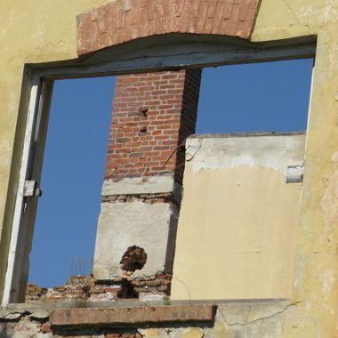 An old, abandoned, decrepit building against a clear blue sky. This image was taken close to Sveti Spas, Bulgaria.