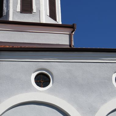 Decorative, church architecture contrasts with a deep blue sky.