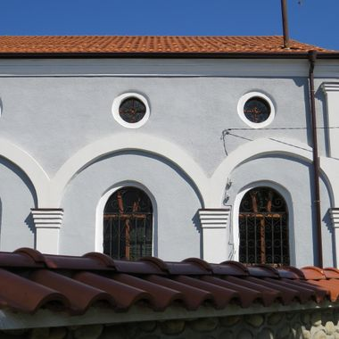 Rooves, of wall and church and windows with decorative arches.