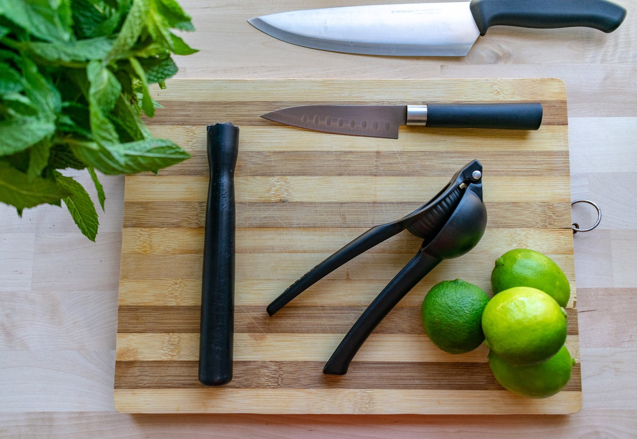 the tools needed and ready for preparing a mojito cocktail