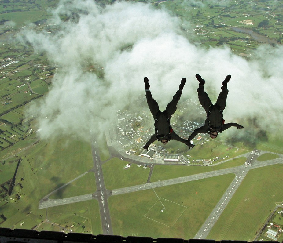 A trainee air dispatcher and an RNZAF PJI free-fall from a 40 Squadron C130 above Auckland&#0...