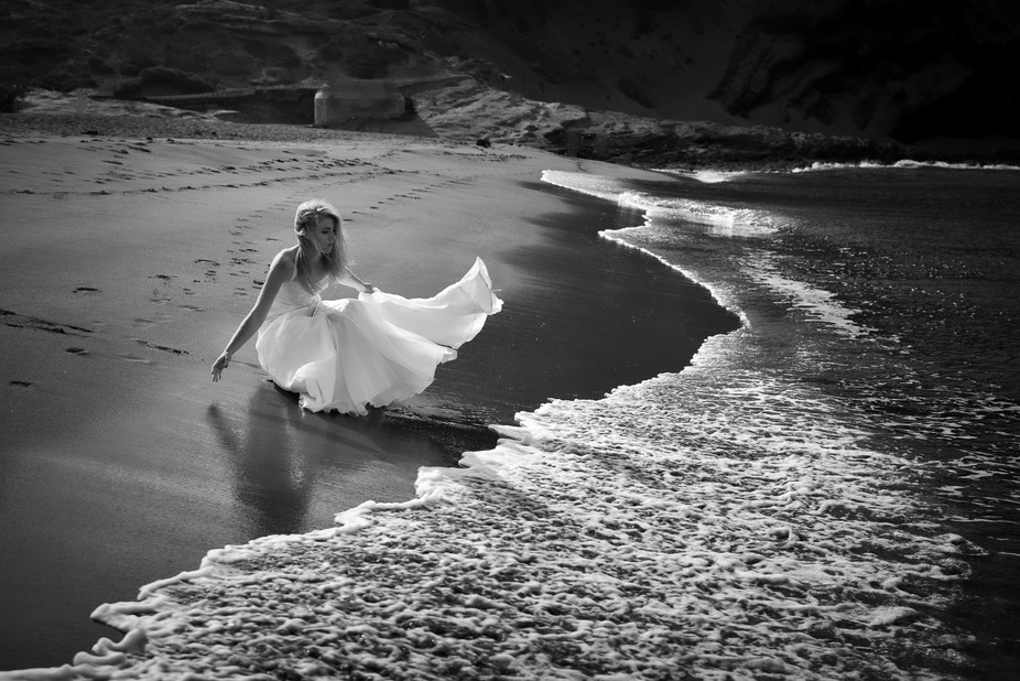 Lonely bride at a beach