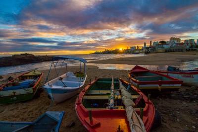 Boats at sunset Rio Vermelho, Bahia, Brazil