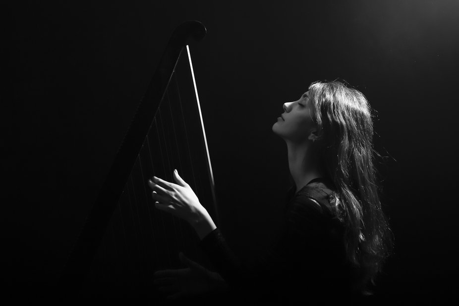 A girl who has harp