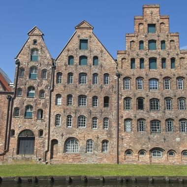 I took this photo when me and my wife went on a boat trip to Norway, Denmark and Germany, in July 2018. After we entered the old town of Lubeck, our guide took us next to the river, where we came to these old historic warehouses called Salzspeicher.