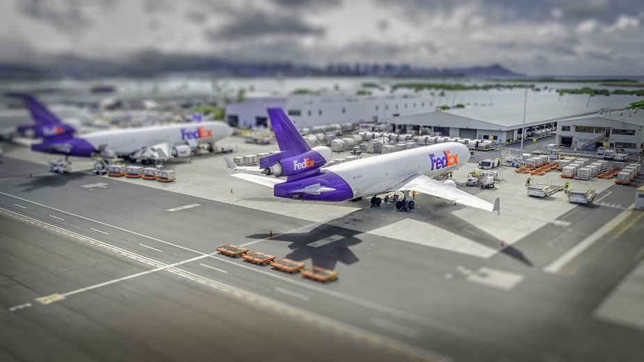 Image of FedEx planes taken while lifting off in helicopter. Edited to make it look like toy planes.