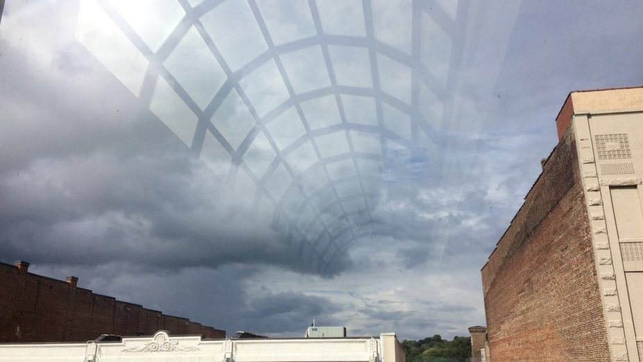 The sky with the reflection of the domed glass Ceiling