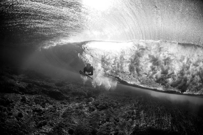 BW Cloudbreak Duck Dive by dnphoto - Our World In Black And White Photo Contest