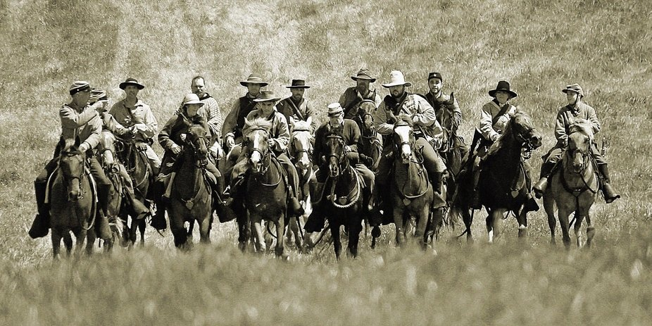 Civil War battle reenactment in Kentucky, participants riding down the hill to prepare