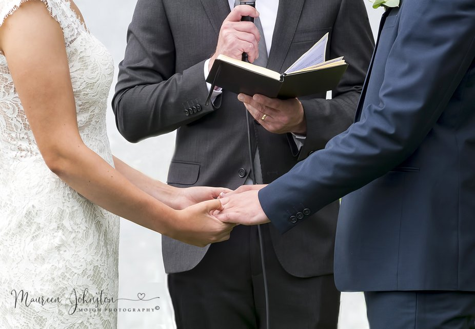 "The Celebrant, reading a Prayer, as the Couple say their ""I Do's""."