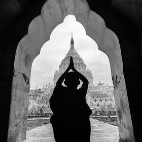 Young monk are praying at Hsinbyume pagoda in Myanmar.