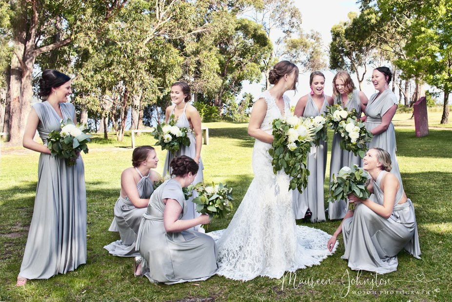 8 Beautiful Hand Maidens attending to the Bride. All enjoying tales of the day together.