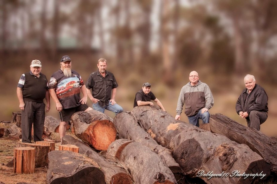 This is my husbands family taken on our property - his father and brothers
