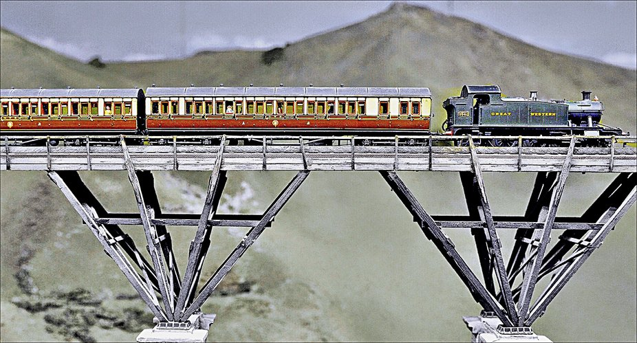 Model Train on Pendon Viaduct in Oxfordshire.