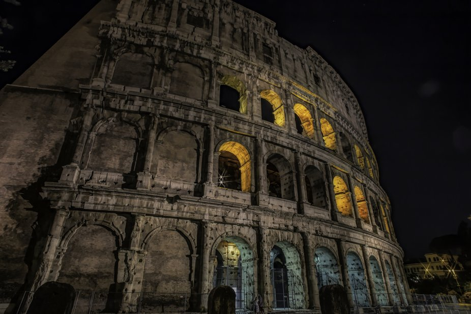 A night shot of the Colosseum in amazing Rome!  It's so difficult to get a photo of this...