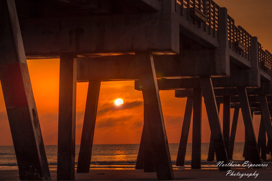 Rising sun underneath the Jacksonville Beach pier.
