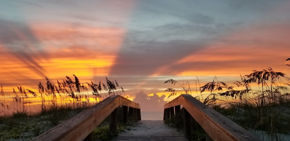 Wow!!!! Took my breath away approaching the vista beyond at Jax Beach, Florida!!! Awww....beach l...