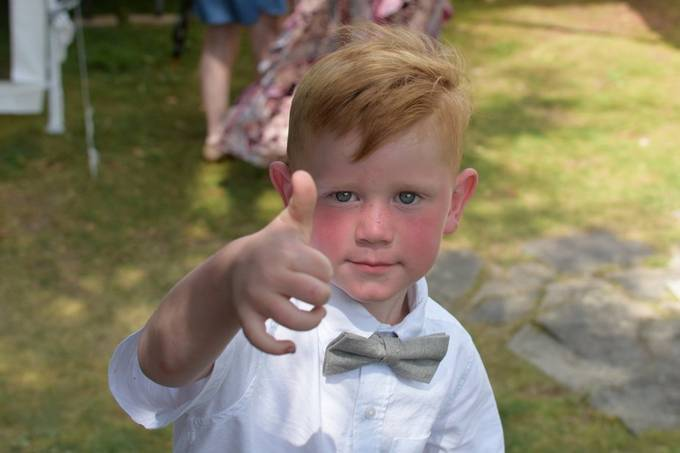 Big thumbs up after nailing his role as a ring bearer!