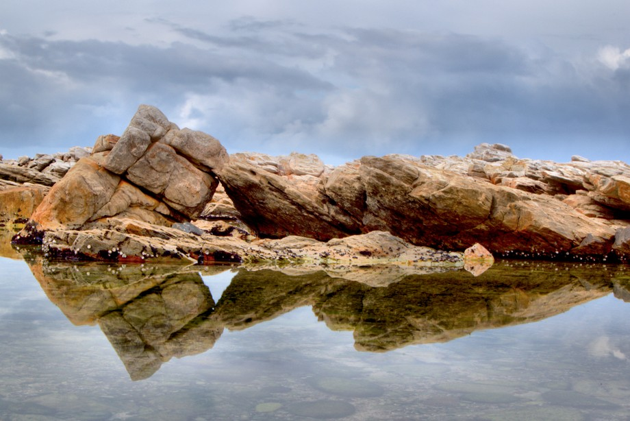 Rocks reflecting in the water