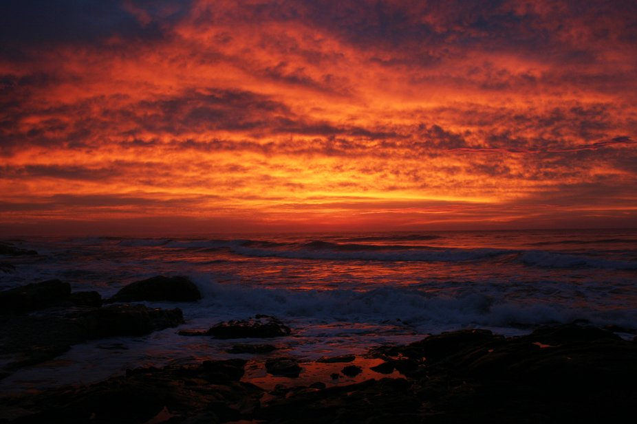 A walk along the beach on this morning revealed a sunrise that light up the clouds in bright red ...
