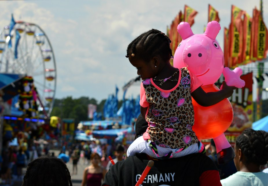 Can't Get any more adorable at the fair.  I assume Daddy won the pink pig for his girl.