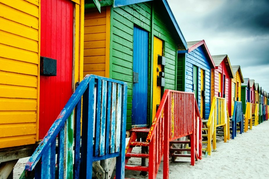 Colorful dressing houses on Muizenberg beach. Truly South African.