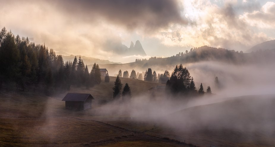 Fields of Fire on The Seiser Alm.  The Schlern in the center of the photo is a mountain in the Dolomites in South Tyrol Italy.  A two shot landscape panoramic shot with the Canon 50mm 1.8.