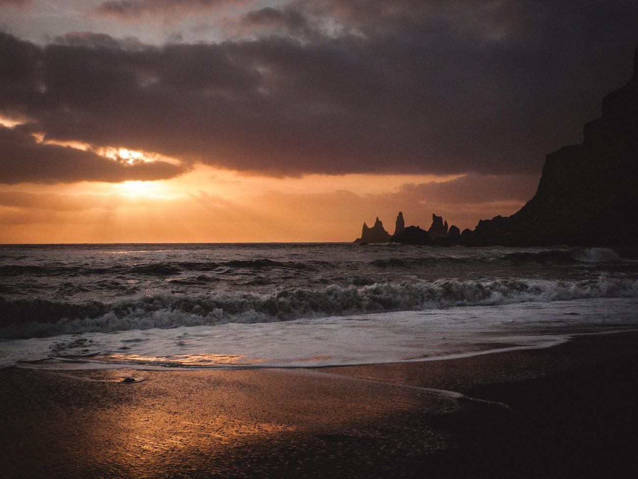 Sunset in Vik, small village on the Iceland south coast. And its famous black sand beach.