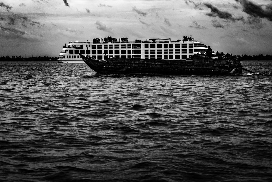 A cruise ship vs a local boat.