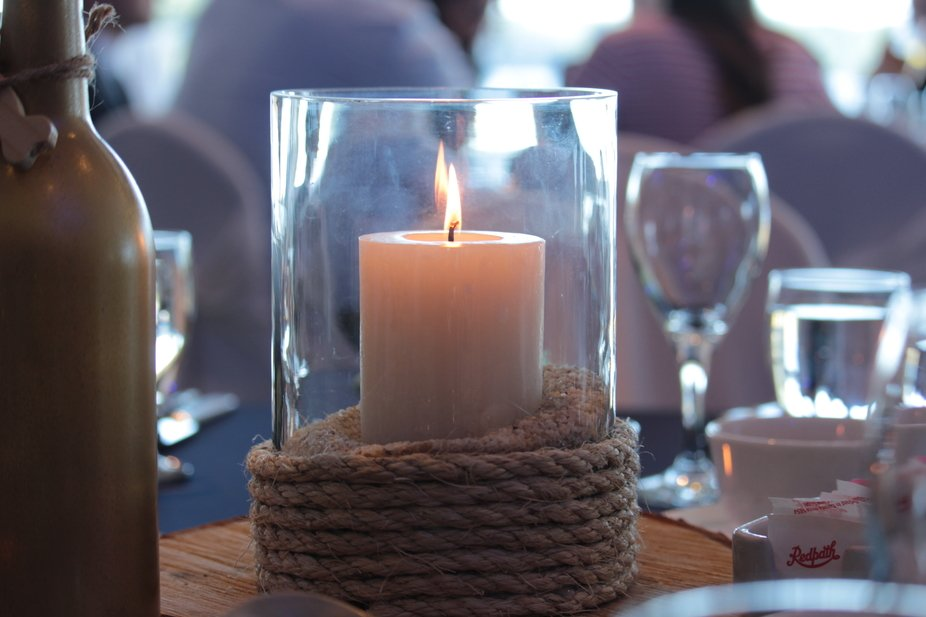A beautiful candle centre piece at a beautiful wedding
