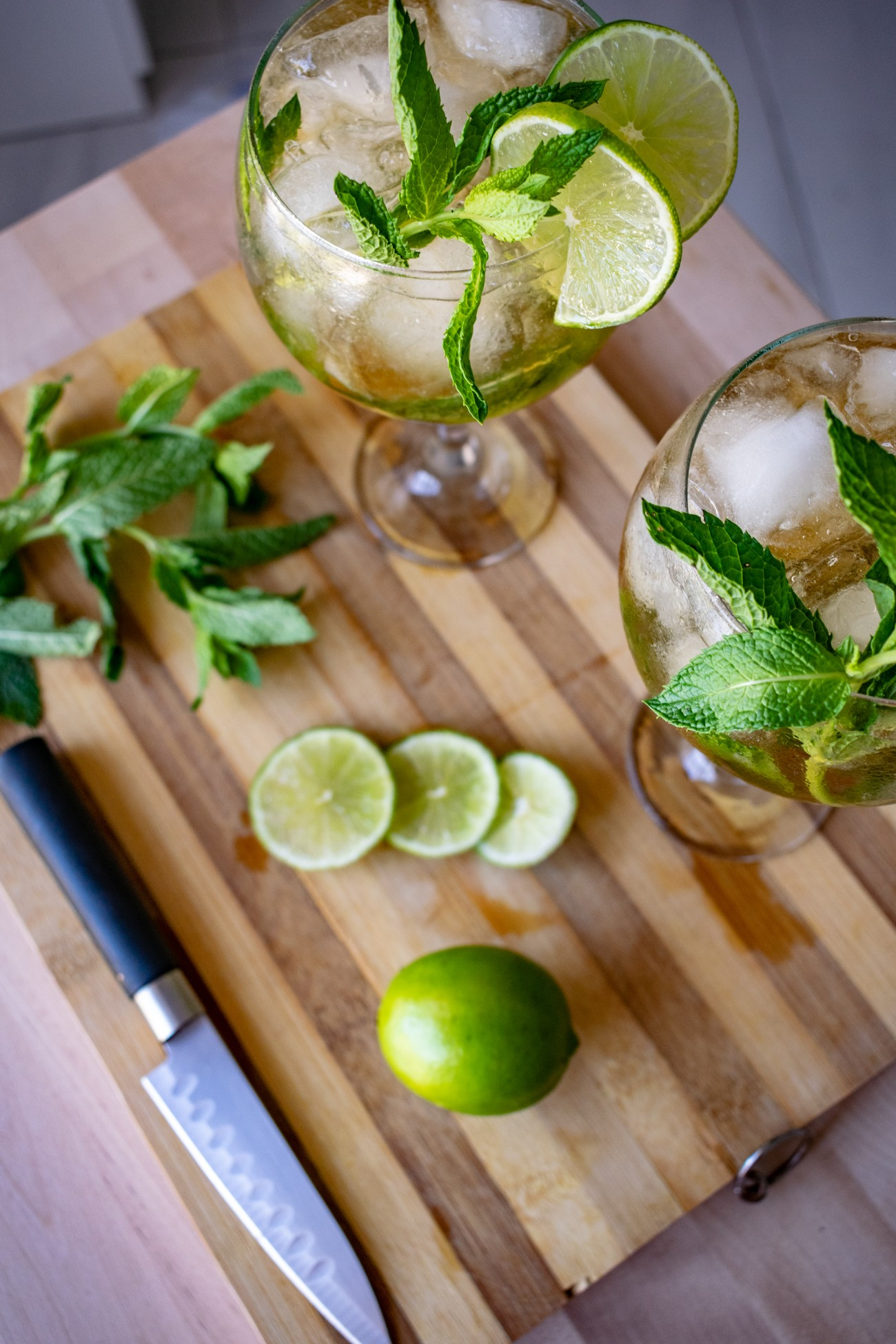 a couple of freshly prepared tropical mojito cocktails