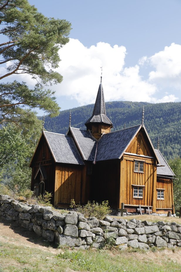 A beautiful stavechurch in a valley in Norway. Exterior is very straight forward, interior still ...