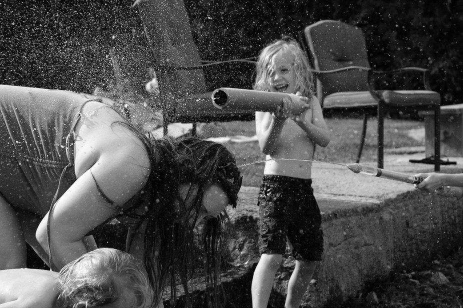 A small boy gets his aunt back after getting soaked in a water gun fight.