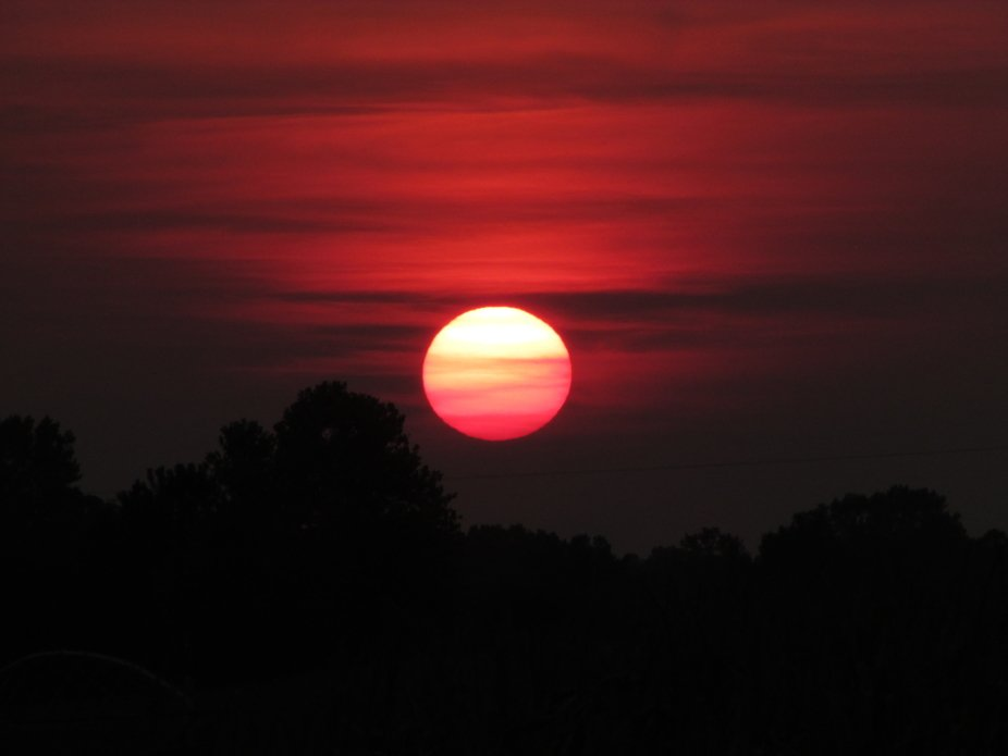 I was on my way home from going to Walmart and this sunset was on the way home. I like the pictur...